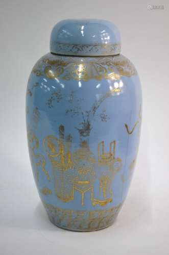 An unusual Chinese claire-de-lune slender oviform vase with domed cover; highlighted in gilt with