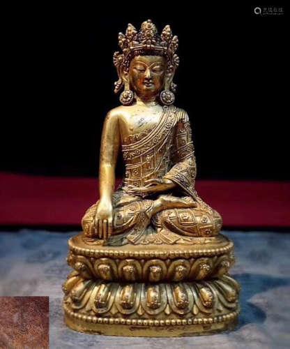 A GILT BRONZE MOLDED BUDDHA STATUE