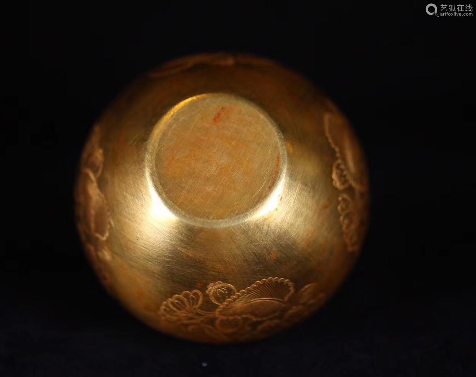 A GOLDEN FLORAL CARVED JAR