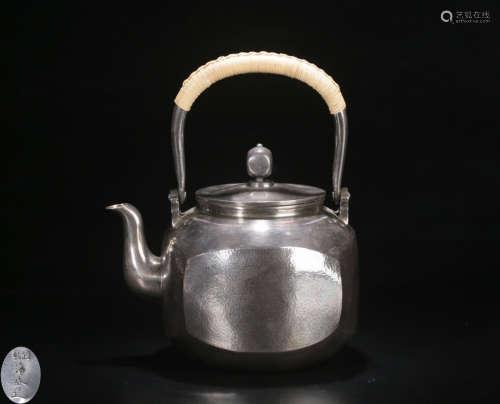 A SILVER CASTED MULTI FACED TEA POT