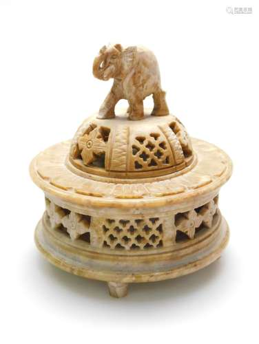 An Indian carved soapstone box, the removable lid with domed cover and elephant finial, finely