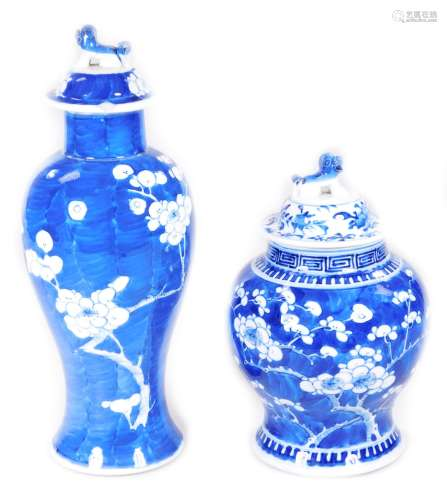 A Chinese Qing period blue and white porcelain prunus vase, of inverted shouldered outline, on a