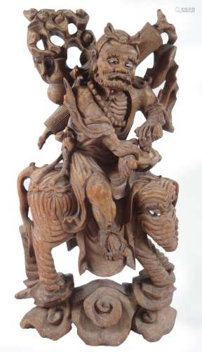 A 19thC root carving, formed as a Chinese gentleman riding on an elephant, on a naturalistic