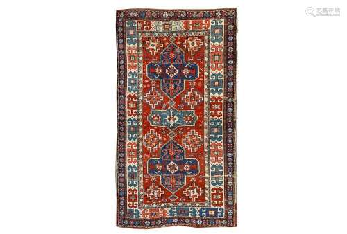 AN ANTIQUE AKSTAFA RUG, SOUTH-EAST CAUCASUS approx: 7ft.7in. x 4ft.(231cm. x 122cm.) The rust