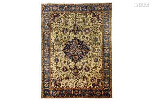 A TABRIZ CARPET, NORTH-WEST PERSIA approx: 12ft.5in. x 9ft.2in.(379cm. x 279cm.) The sandy-beige