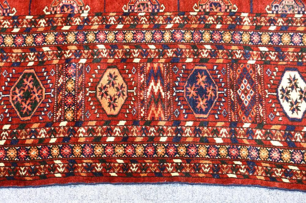 A FINE ANTIQUE BOKHARA CARPET, EAST TURKMENISTAN approx: 9ft.7in. x 7ft.3in.(291cm. x 221cm.)