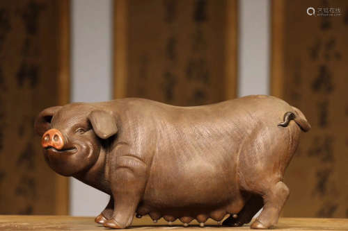 A SOW DESIGN PURPLE CLAY ORNAMANT