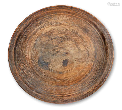 A large turned timber Winowing tray, probably Indian