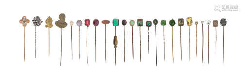 Twenty-four assorted stick pins, one set with an old circular-cut yellow diamond, a star sapphire,