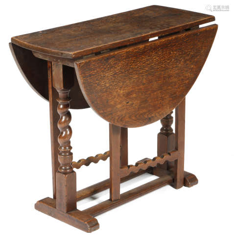 A William and Mary oak gateleg table, the oval drop-leaf top on block and spiral twist ends, the
