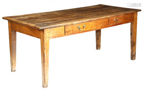 A 19th century French cherrywood farmhouse kitchen table, the boarded top with cleated ends, with