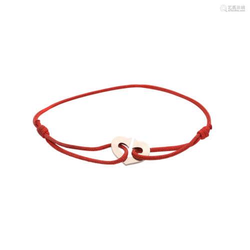 CARTIER Love C Armband,WG 18K an roter Kordel, versch. Längen möglich. Mit Tragespuren.Gewicht 3,