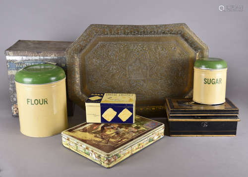 A collection of early 20th Century tins and metalware, including a cash box, Huntley and Palmer