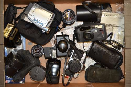 An Olympus OM-2N SLR Camera and Lenses, OM-2N body, serial no 736514, shutter working, with three
