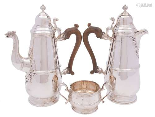 A George V matched silver three-piece coffee service: maker Mappin & Webb, London,