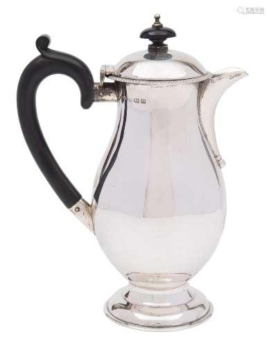 A George V silver hot water jug, maker RR, Birmingham, 1913: of plain baluster form,