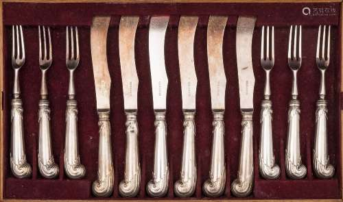 A set of pistol grip knives and forks with unmarked handles: having steel blades and tines,