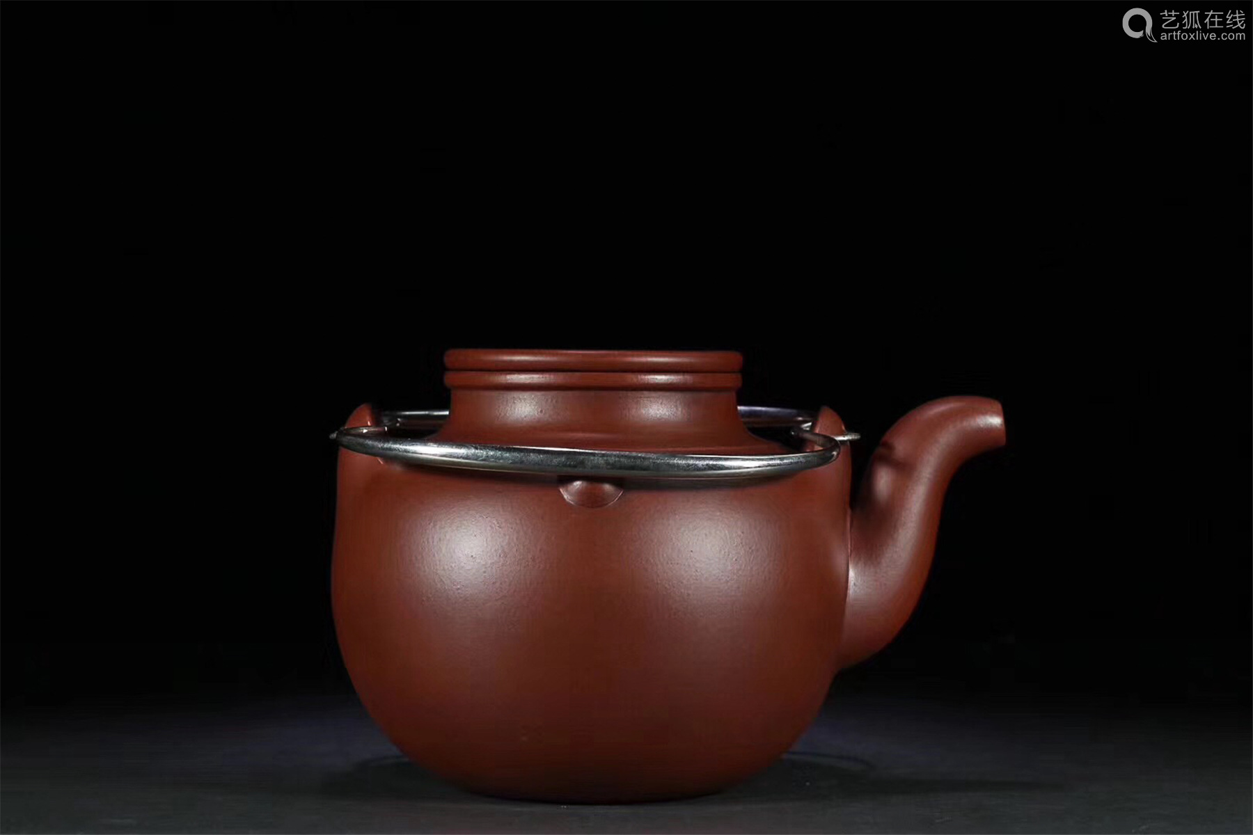 A SILVER HANDLE PURPLE CLAY TEAPOT
