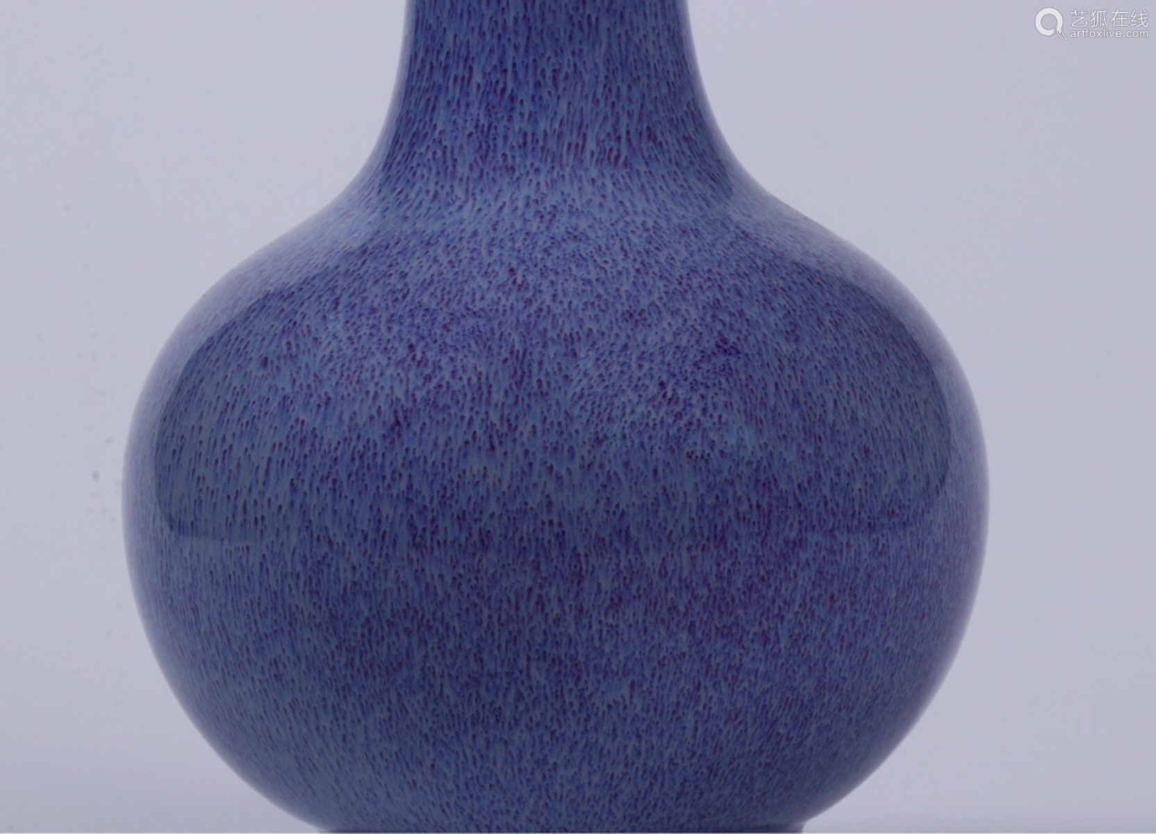 A BLUE GLAZED GLOBULAR VASE