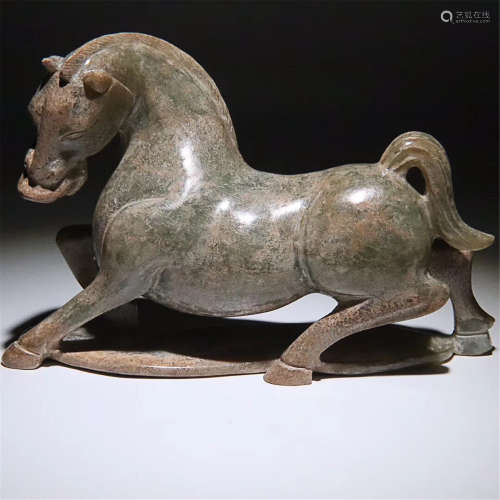A CARVED HETIAN JADE LAY HORSE ORNAMENT
