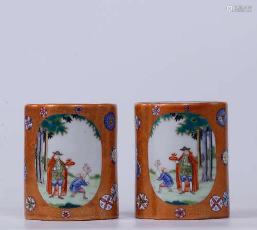 A PAIR OF STORY DESIGN RED GLAZED BRUSH POTS