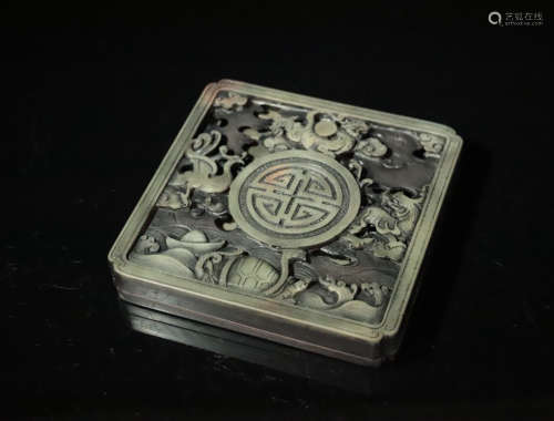 A STONE CARVED INK SLAB