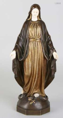 Antique bronze Madonna with ivory face, hands and feet.