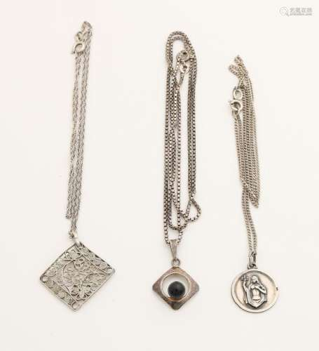 Three silver necklaces with various pendants. total