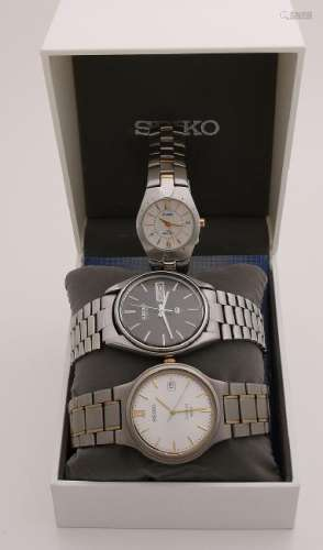 Two seiko men's watches, a round titanium model with