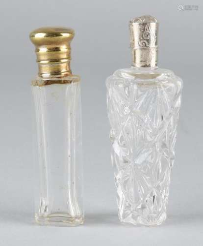 Two crystal odeo vials, one cylindrical model with