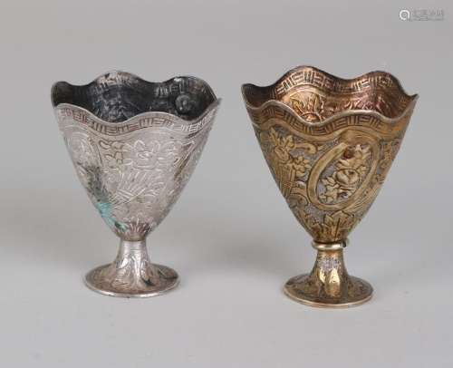 Two silver cups,> 800/000, one holder engraved with