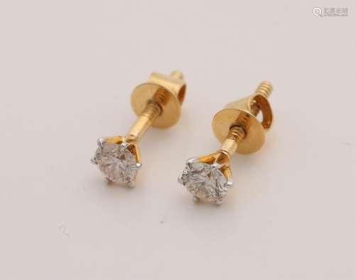 Yellow gold ear studs, 585/000, with diamonds. Soliatir