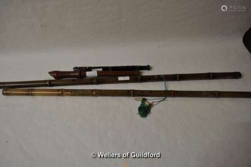 Two Chinese bamboo end flutes, the longest 84.5cm, a small woodwind instrument and a recorder (4).