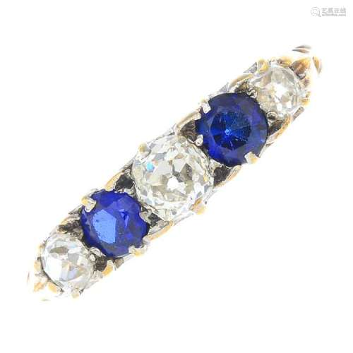A diamond and sapphire five-stone ring. The old-cut