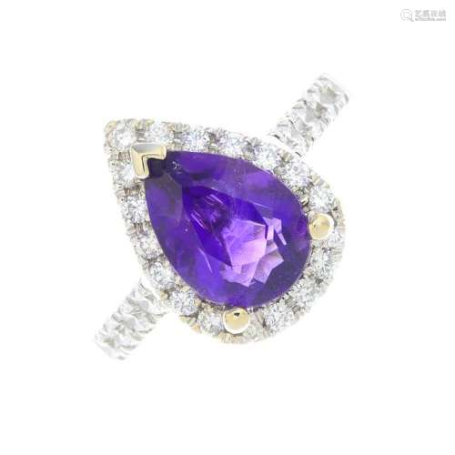 An 18ct gold amethyst and diamond cluster ring. The