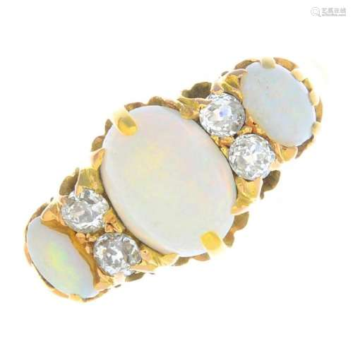 A late Victorian 15ct gold opal three-stone and diamond