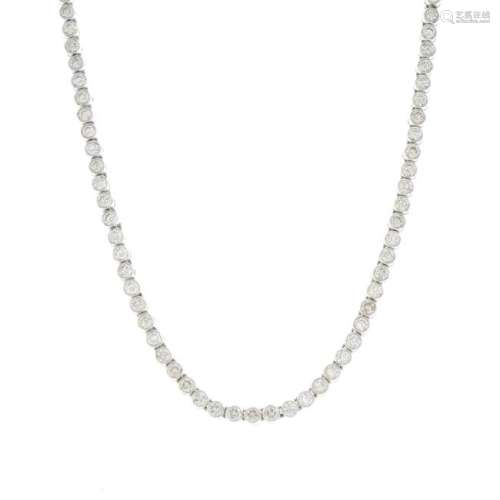 An 18ct gold diamond necklace. Designed as a