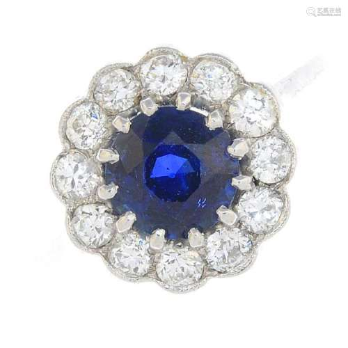 A Sri Lankan sapphire and diamond cluster ring. The