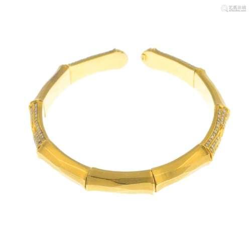 A diamond flexible bangle. The stylised bamboo open