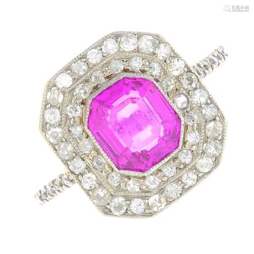 A Burmese sapphire and diamond cluster ring. The