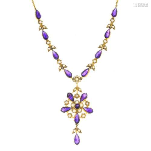 An Edwardian gold amethyst and split pearl necklace.