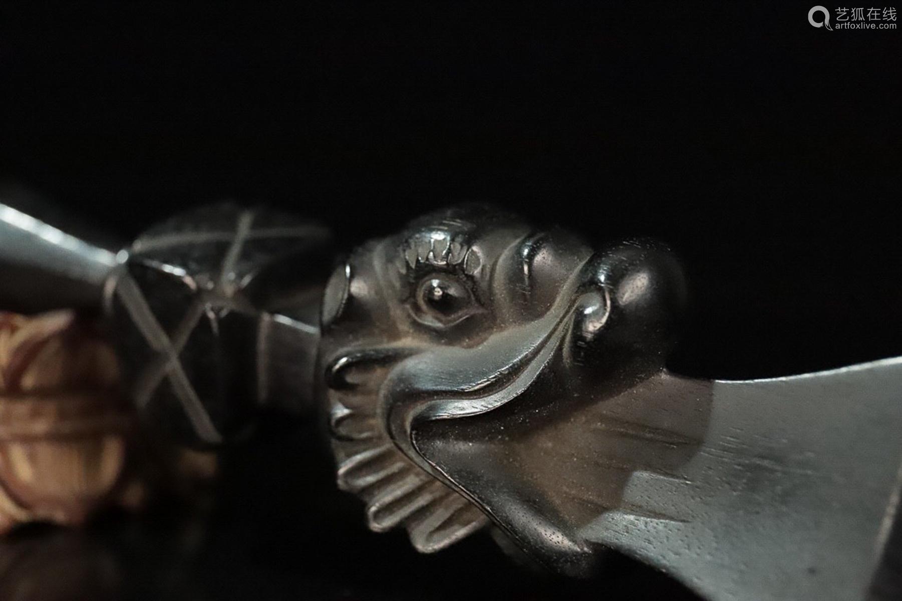 A ZITAN WOOD CARVED DRAGON PATTERN PENDANT