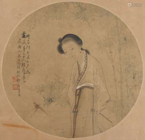A late 19th century Chinese painting on circular silk panel depicting a lady by bamboo, with