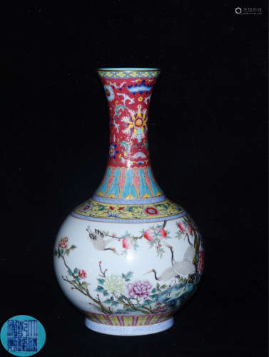 A FAMILLE ROSE WRAPPED LOTUS PATTERN VASE