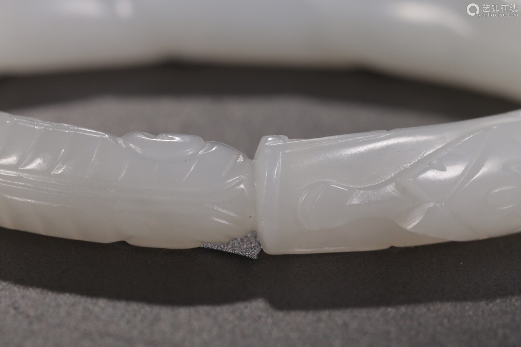 A HETIAN JADE CARVED BANGLE