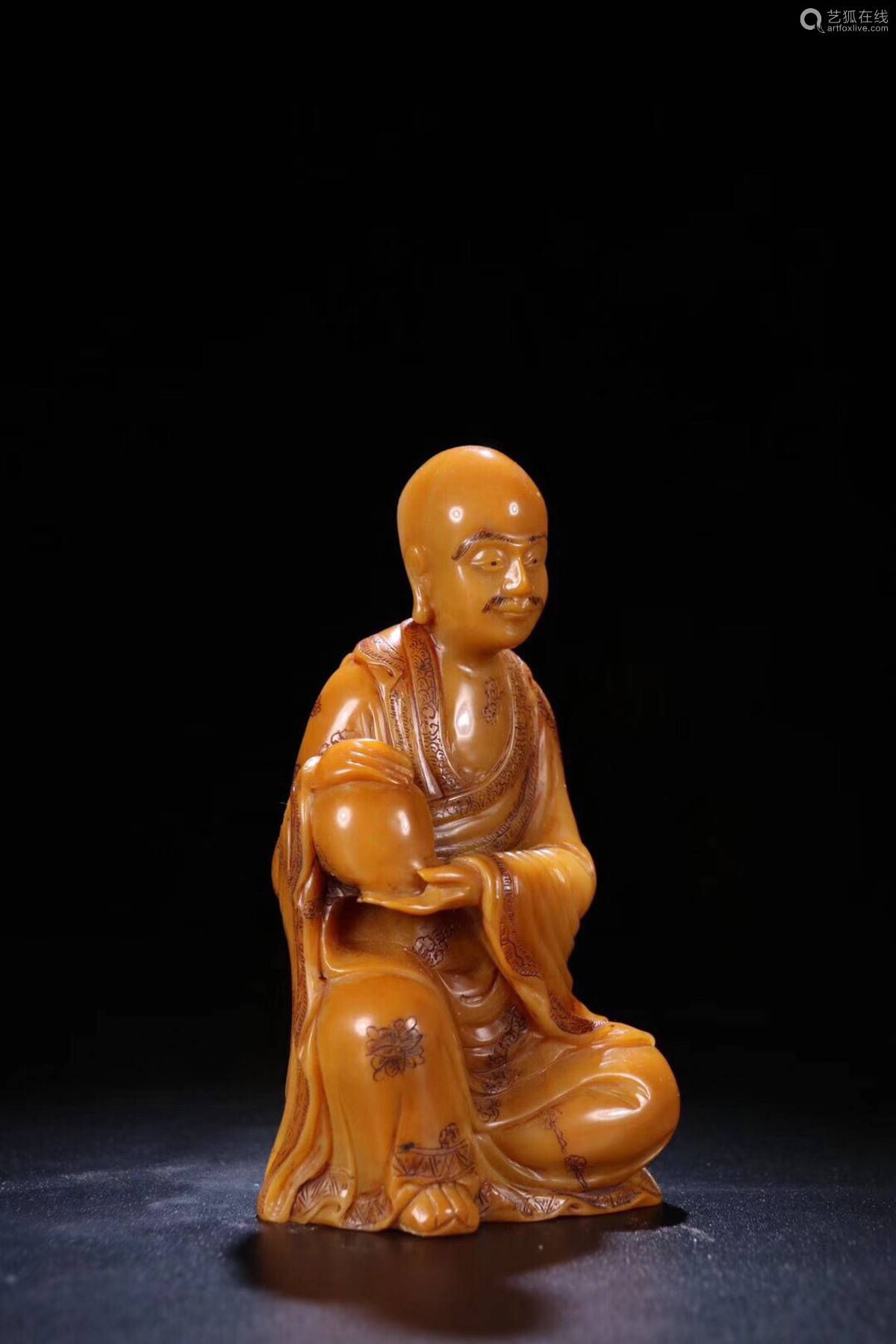 17-19TH CENTURY, A FIELD YELLOW STONE CARVED ARHAT STATUE,QING DYNASTY
