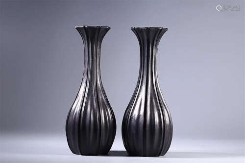 A PAIR OF ROSEWOOD VASES