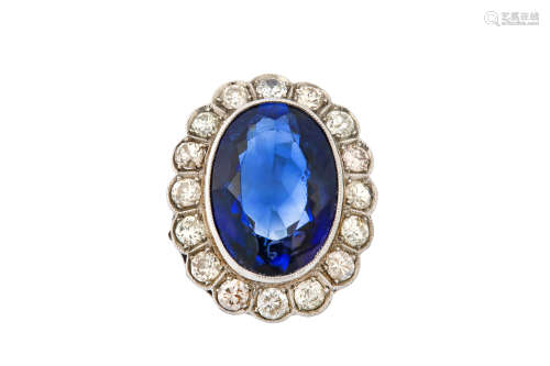 A synthetic sapphire and diamond ring