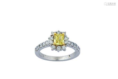 A fancy coloured diamondand diamond cluster ring