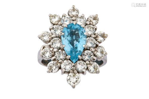A diamond and blue topaz cluster ring